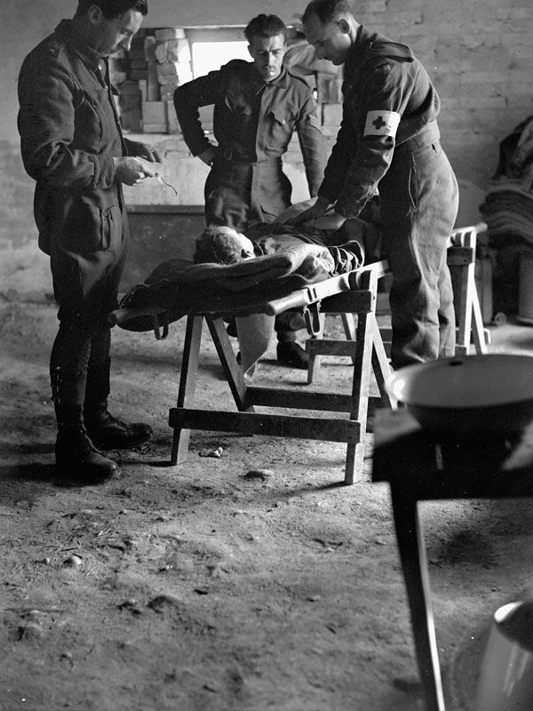 Personnel of the Royal Canadian Army Medical Corps checking the condition of a wounded Canadian soldier being evacuated to a Field Surgical Unit, Italy, January 15, 1944. (L-R): Major P.K. Tisdale, Staff-Sergeant W.H. Brigham and Private L.P. Lemieux. Photograph by Lieutenant Alex M. Stirton. My grandfather belong to the Canadian medical corp