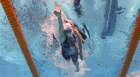 Missy Franklin de los EE.UU. es visto bajo el agua la que nada en 100m estilo libre calores de las mujeres durante los Campeonatos del Mundo de Natación en el estadio de Sant Jordi en Barcelona 1 agosto de 2013. REUTERS / Michael Dalder