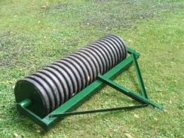 Cultipacker Homemade cultipacker constructed from a plastic culvert, grease fittings, tubing, angle iron, and concrete
