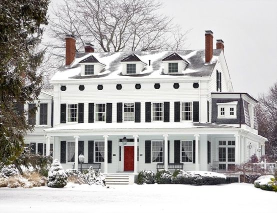 White colonial, black shutters, red door and snow? Perfection. Simple PERFECTION!