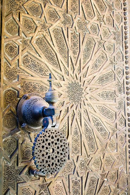 Heavy metal doors to the Bou Inania complex in the Medina of Fes.  Photographer: Christopher Rose