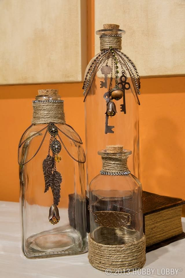 bottles Pic is from hobbylobby.com and has no instructions but pretty simple Using jute/twine wrap around your bottles (I would use a little craft glue where your going to wrap the twine) add old chains and jewelry to them. fun to go thrift store shopping for old necklaces and more to decorate these  With these your only limited by your imagination