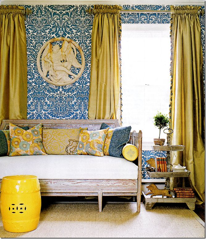 chartreuse silk curtains with tassel trim blue and white walls yellow garden stool daybed fiona newell weeks from southern living style