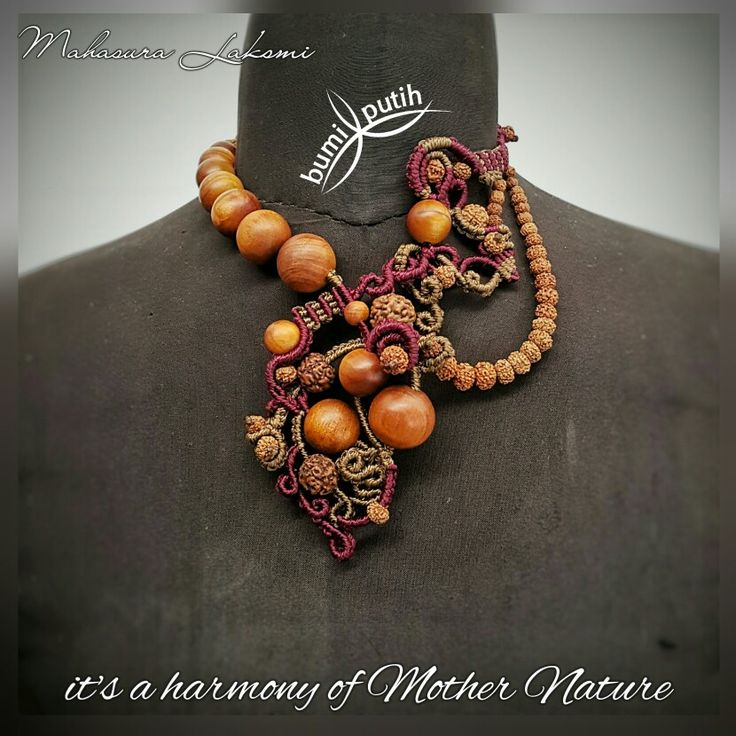 The necklace of MAHASURA LAKSMI. This pieces made with freestyle macrame technique, combined with various size natural agathis (king of wood)  wooden beads, various natural rudraksha seeds, and coconut shell buttons. Knotted with nylon cords.  Being thankful to Mother Nature and The Creator for all the blessings