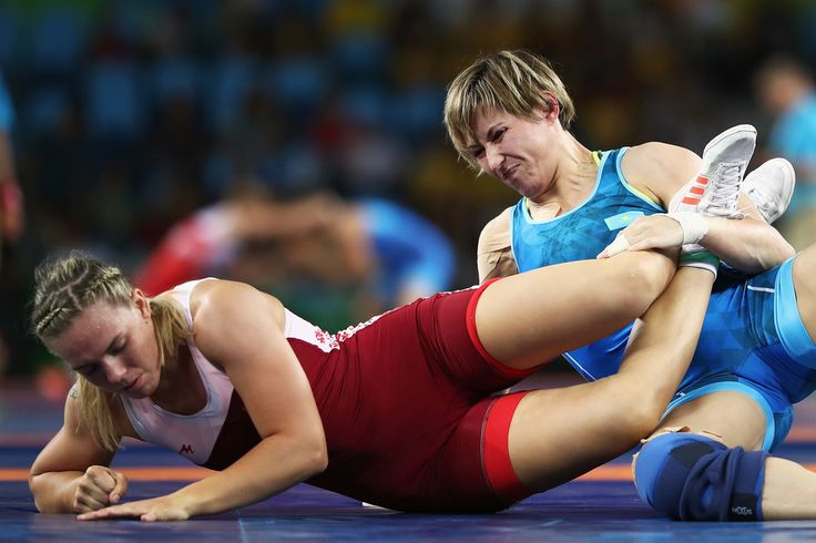 Guzel Manyurova of Kazakhstan (blue) competes against Zsanett Nemeth of Hungary during the Women's Freestyle 75 kg 1/8 Finals on Day 13 of the Rio 2016 Olympic Games at Carioca Arena 2 on August 18, 2016 in Rio de Janeiro, Brazil.
