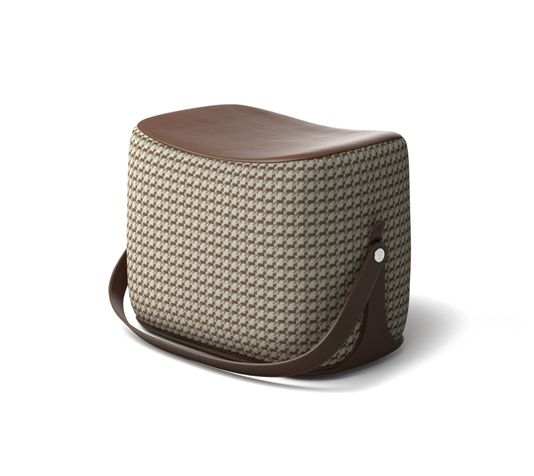 """Ottoman Hermes ottoman with strap that makes it highly portable. L21.1"""" x H14.1"""" x W13.6"""". Storage area covered in chocolate leather.<br />Cover in taupe """"Cheval Pixel"""" fabric.<br /><br />Recalling the shape of a saddle, the ottoman offers small occasional seating and occasional storage.<br />This piece is crafted in the style of fine leather goods and requires intricate craftsmanship.<br />"""