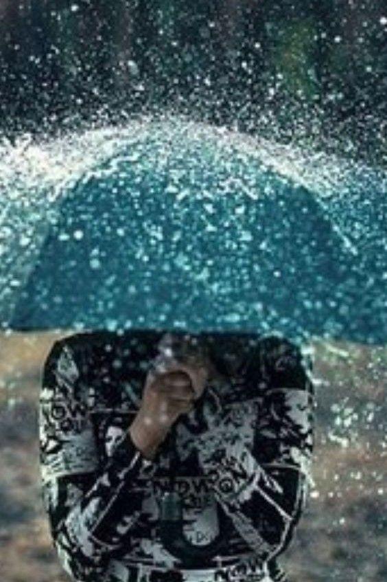 umbrella doing its best in the rain