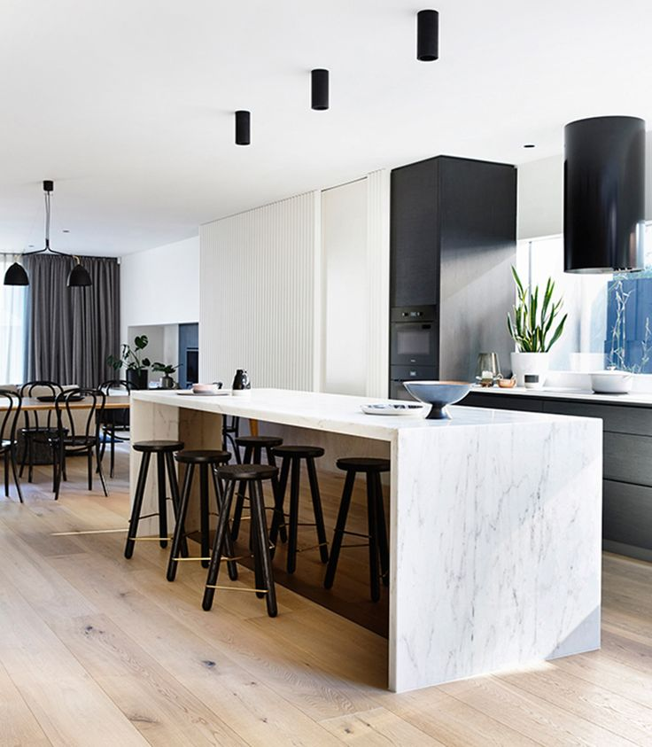 Simple and awash in beautiful textiles, the Elwood Townhouse by Inform Design is full of organic finished in marble, travertine, concrete and oak.