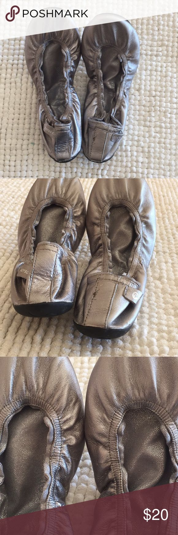 Real Leather Silver Metallic Ballet Flats These gorgeous silver ballet flats are easily folded up for storage in a purse or backpack. They're real leather and have a comfortable lining that keeps your feet dry and warm. They've never been worn. Corso Como Shoes Flats & Loafers