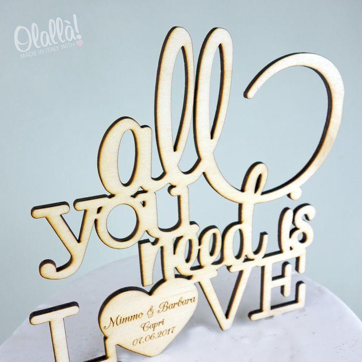 """Meraviglioso cake topper con la scritta """"All I need is your love"""" personalizzata con i vostri nomi e la data del matrimonio all'interno del cuore. Dimensioni a scelta. Colori a scelta. Per ogni informazione contattateci a servizioclienti@olalla.it"""