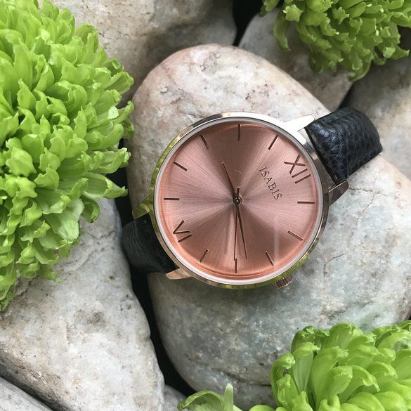 ISABIS WATCH | Hello Pretty. Buy design. Ethereal rose gold flecks sprawl over the sunray dial of a charming round watch accented with a highly polished case and a lightly textured leather strap. 40mm case; 11mm band width. Buckle closure. Three-hand quartz movement. Mineral crystal face. Stainless steel/rose gold plate/pineapple leather. By ISABIS imported.
