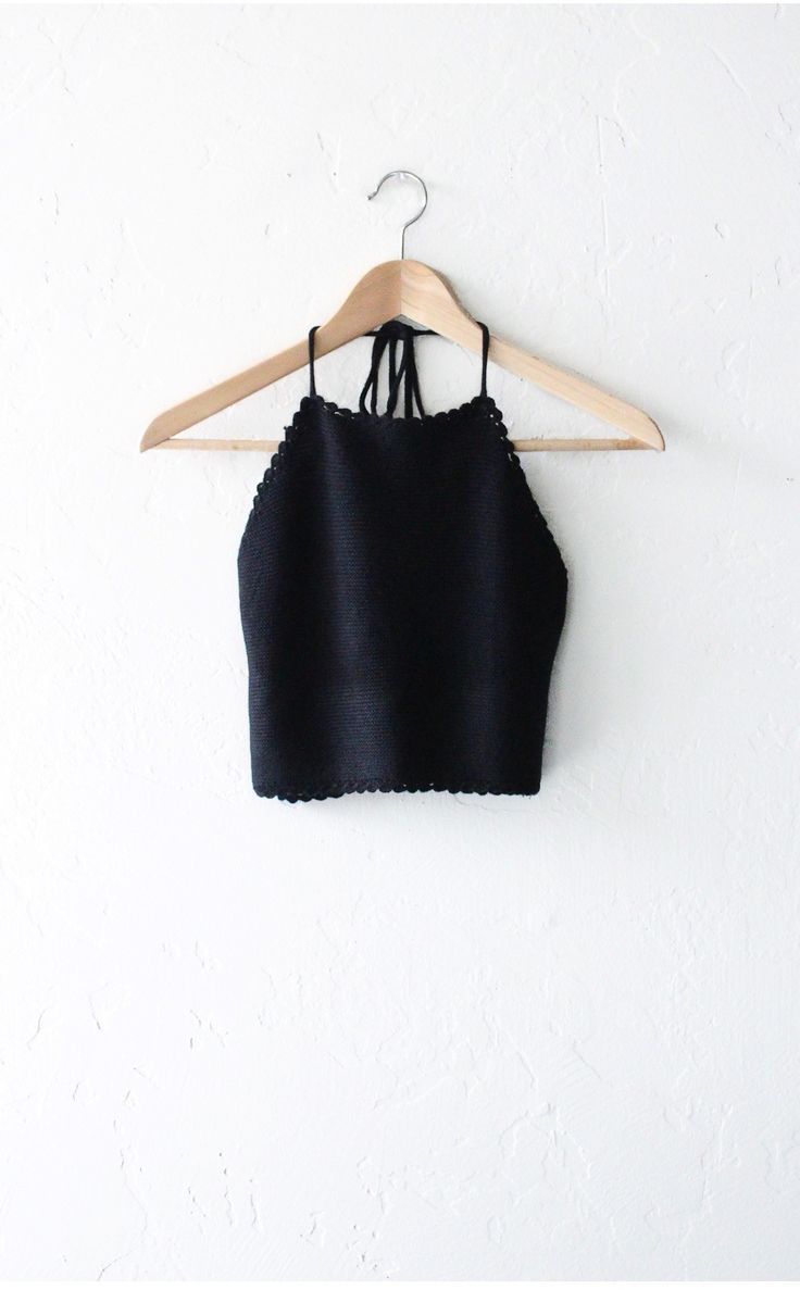 - Description - Size Guide Details: Soft & stretchable sweater knit halter crop top in black with adjustable self-tie around neck & low straight back. Form fitting, tend to run on the smaller side & a