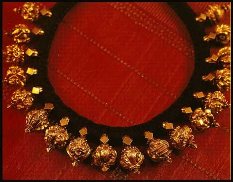 Rudraksha mala with gold casing, each piece uniquely carved with images of gods and goddesses.
