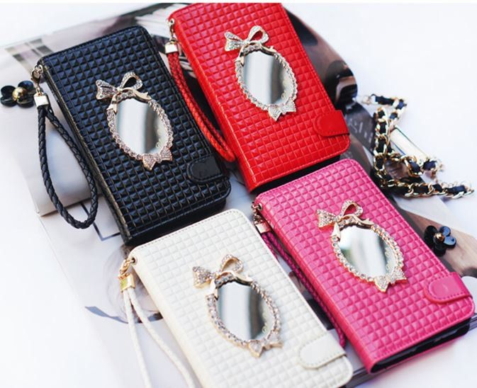 Show off your personality with this girly and charming wallet case for iPhone 6! If you don't want to carry a bag, the Billa Bon Mirror Double Wallet Case might be the perfect item for you! With no more than 6 card slots and 2 internal pockets, you can leave your wallet at home! A ribbon shaped mirror is attached on the front and a convenient phone strap is included.