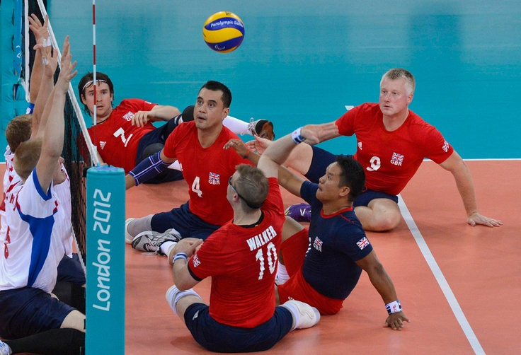 British players (right) return the ball as they compete against Russia during their Men's Sitting Volleyball preliminary match on Aug. 30. (Toby Melville/Reuters)