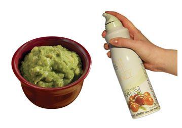 Spray the top of guacamole with cooking spray and place in fridge.  Next day it will still be green.