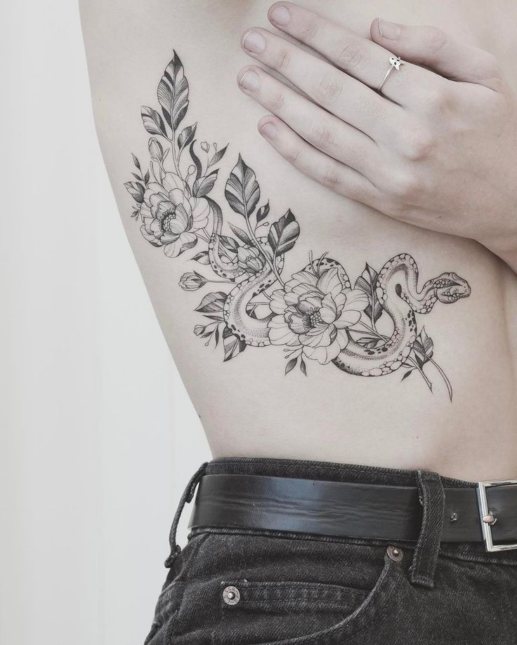 fineline snake and flowers tattoo on the ribs