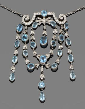 An aquamarine and diamond necklace and a pair of b…