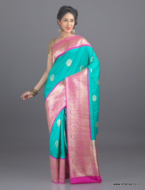 Only highly skilled artisans can weave out a wonder like this Banarasi saree which trends large leaf motifs all through the saree and exceptional zari work on the double border. Made from the luxurious and celebrated Katan silk, these traditional Banarasi Silk Sarees Online are truly authentic and are world renowned as the finest real zari silk sarees and traditional wedding silk sarees.