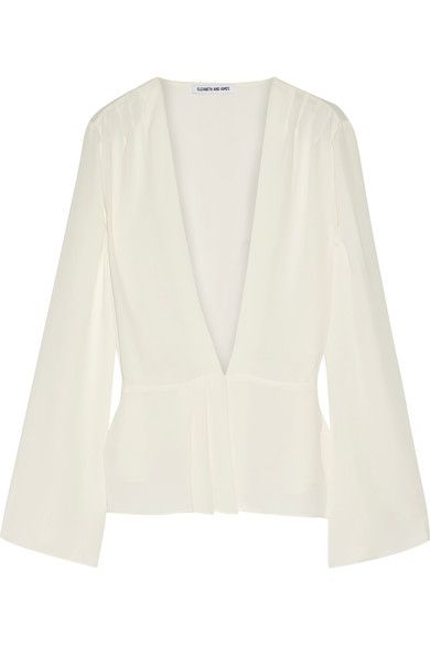 Elizabeth and James' 'Layla' blouse is cut from ivory georgette in a flattering wrap silhouette. A chic everyday choice, it has wide sleeves and front pleating to define your waist. Wear it alone or layered over a turtleneck top.