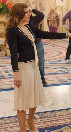 Amy Adams' black sweater with white trim, in the movie American Hustle, goes well with everything!