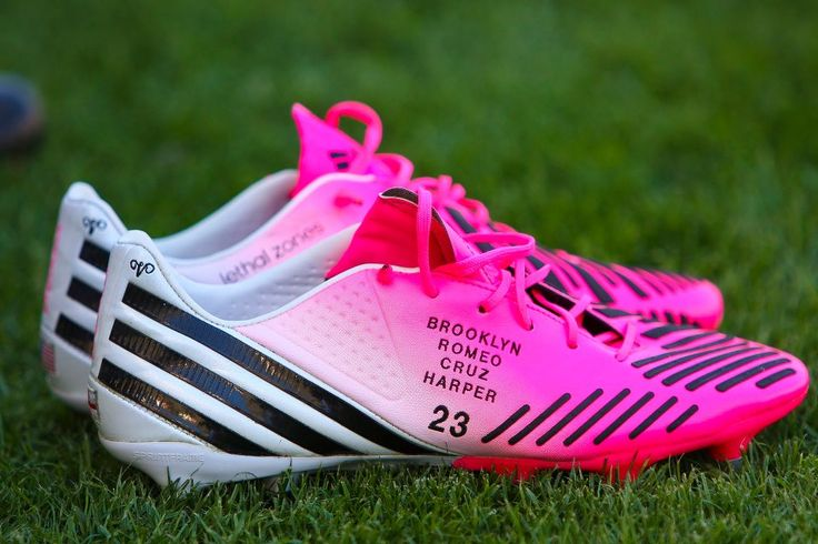 David Beckham's cleats have his kids name on it.