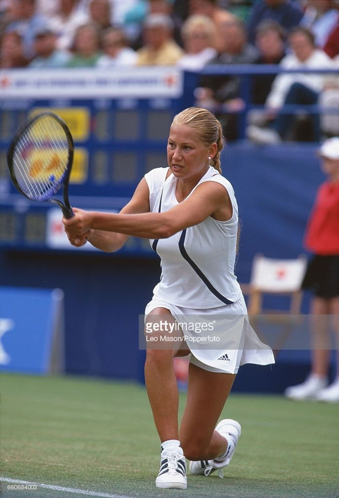 Russian tennis player Anna Kournikova pictured in action during competition to reach the quarterfinals of the Direct Line International Championships tennis tournament at Devonshire Park Lawn Tennis Club in Eastbourne, England in June 2000.