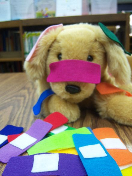 Prepositional concepts, body part vocabulary, following directions, answering What happened questions?   (Put the bandaid on the dog's nose....).  Great activity to use during a vetenarian dramatic play to increase language.