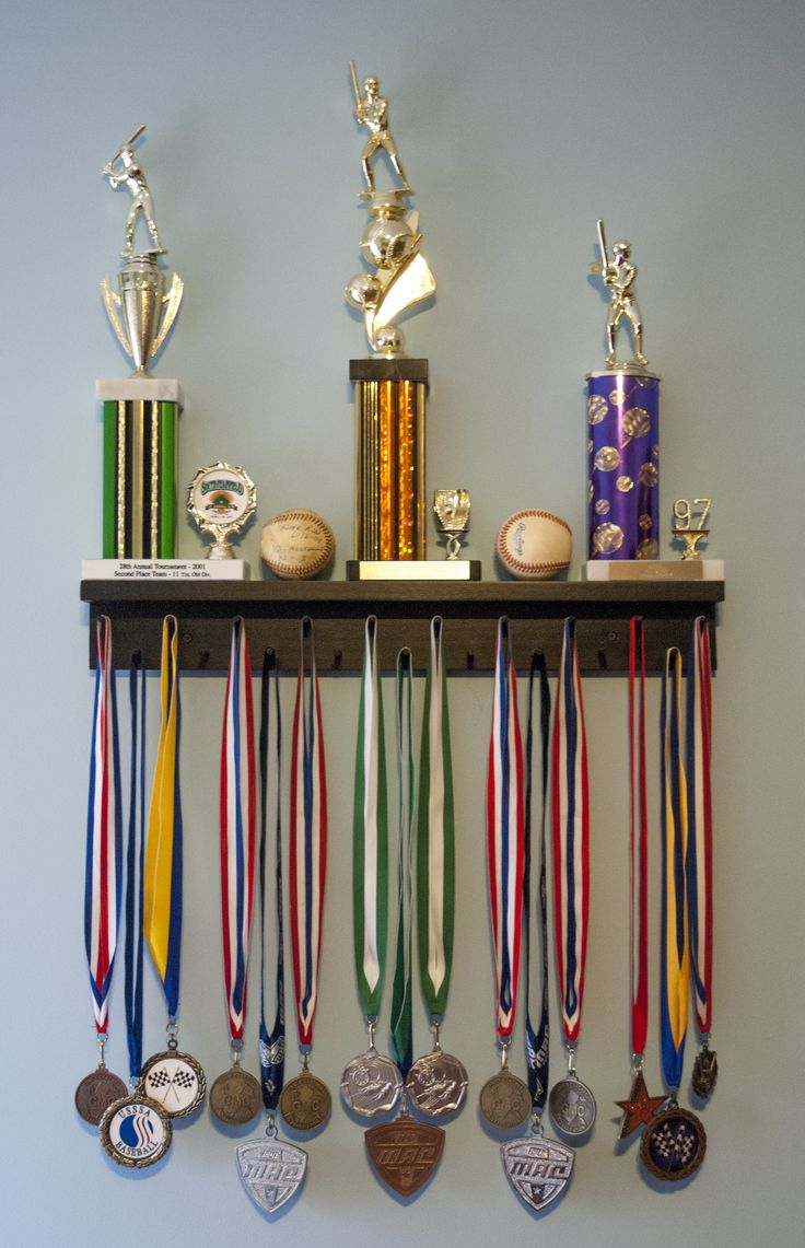 2 Ft Award Medal Display Rack in Black. Showcasing Trophies, Lanyard Medals, and Baseballs for display.