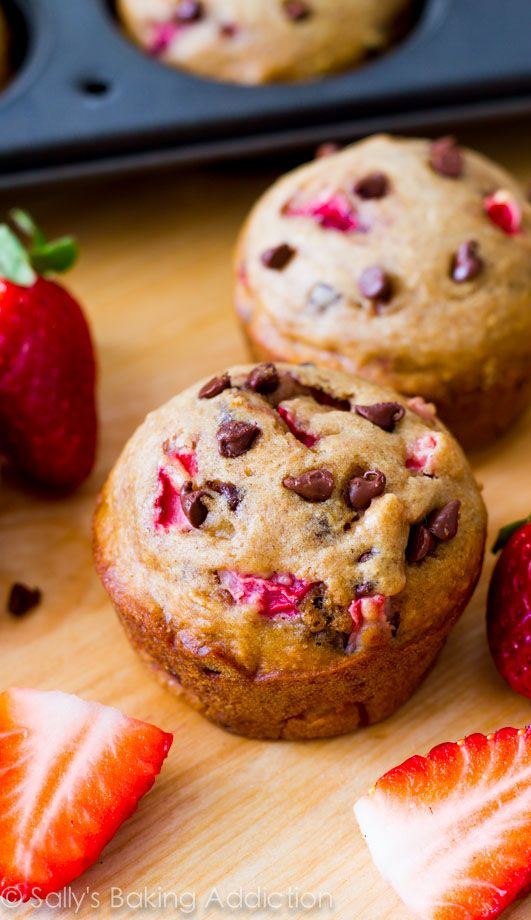 """Incredible """"lightened-up"""" chocolate chip muffins with fresh strawberries. Nearly fat-free and only 140 calories each! @sallybakeblog"""