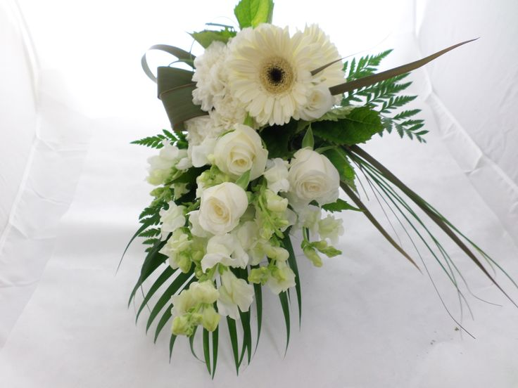 Trailing wedding bouquet in whites and greens, white roses, white gerberas, white snapdragons. Created by Florist ilene, Hamilton, NZ