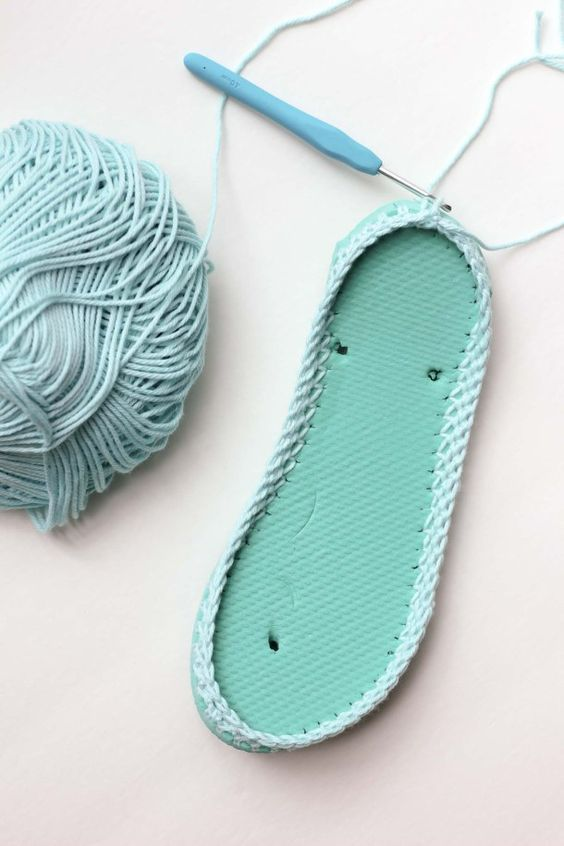 Cotton yarn and a flip flop sole make this free crochet slippers pattern perfect for warmer weather. Click to get the full pattern. | MakeAndDoCrew.com:
