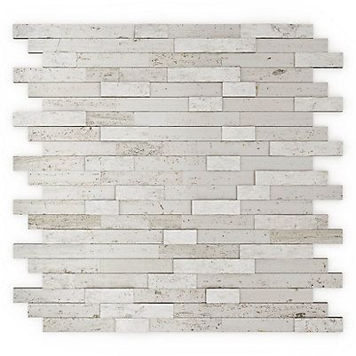 Tuiles auto-adhésives en pierre. Couleur Pierre blanche.Simple et rapide à installer. Facile à entretenir. Modèle sans coulis. Peut être installé sur tous les murs sauf dans la douche et en dosseret pour cuisinière au gaz. Donne un aspect luxueux à la pièce.