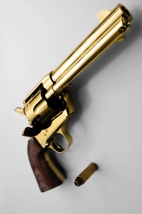 Golden Colt 45 with big ass 45 cartridge.