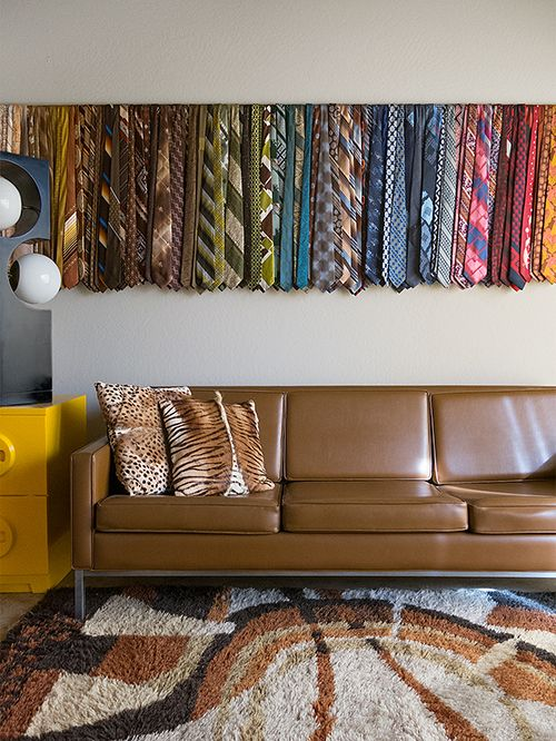 Design*Sponge / 52 Brilliant Ideas for Organizing: Got too many scarves or ties? Store them and make art at the same time by hanging them on a wall-mounted wire!