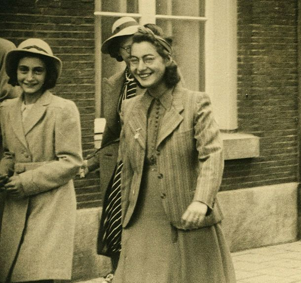 Anne Frank with to her right Jewish Opekta employee Esther, arrive for the wedding of Jan and Miep Gies, 1941. Esther died in one of the Nazi concentration camps.