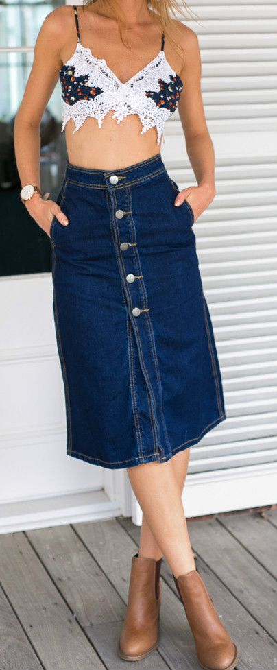 This street look denim skirt you can't miss. The skirt is featuring high waist, front button closure, front slit, side pocket, solid color and mid-calf length.