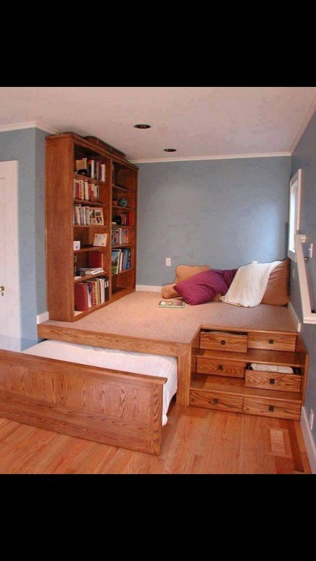 King size pull-out bed beneath a platform alcove, which can be used for storage and relaxation. I would make that my writing space, with a desk and shelves on each side.