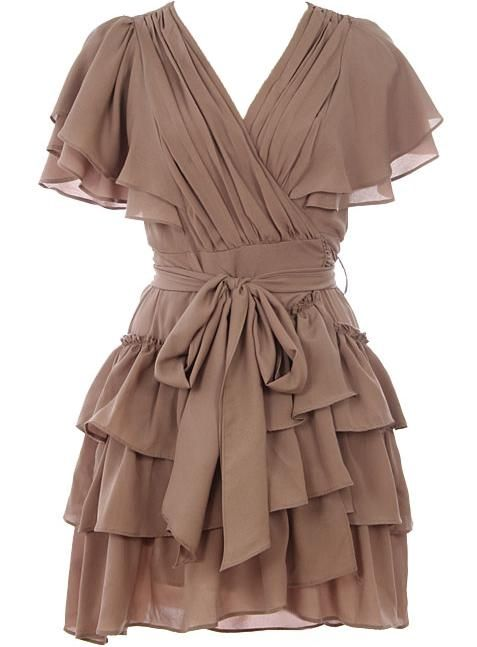 Cappuccino Cascade Dress: Features a wrapped surplice bodice framed by layered flutter sleeves, beautiful paneling to the waist and upper back, adjustable rear ribbon ties, and an extravagant ruffled hem to finish.