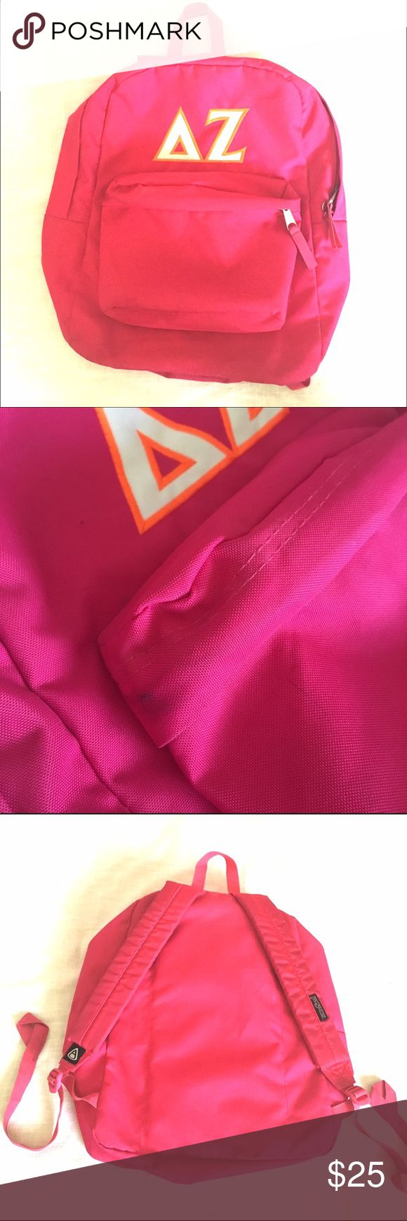 Delta Zeta Backpack Hot pink Jansport backpack with white Delta Zeta letters embroidered on with orange stitching. In very good condition, except there are some spots (just dirt) that are hardly noticeable unless you look very closely. Jansport Bags Backpacks