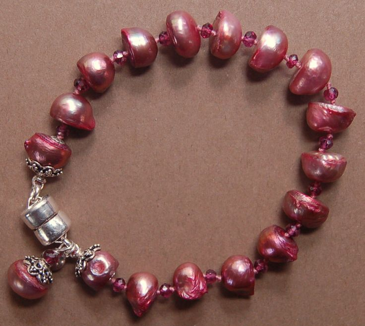 A personal favorite from my Etsy shop https://www.etsy.com/listing/244574713/hand-knotted-garnet-gemstone-beads-mauve