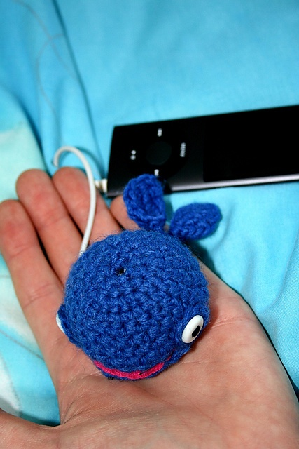 whale earbud holder