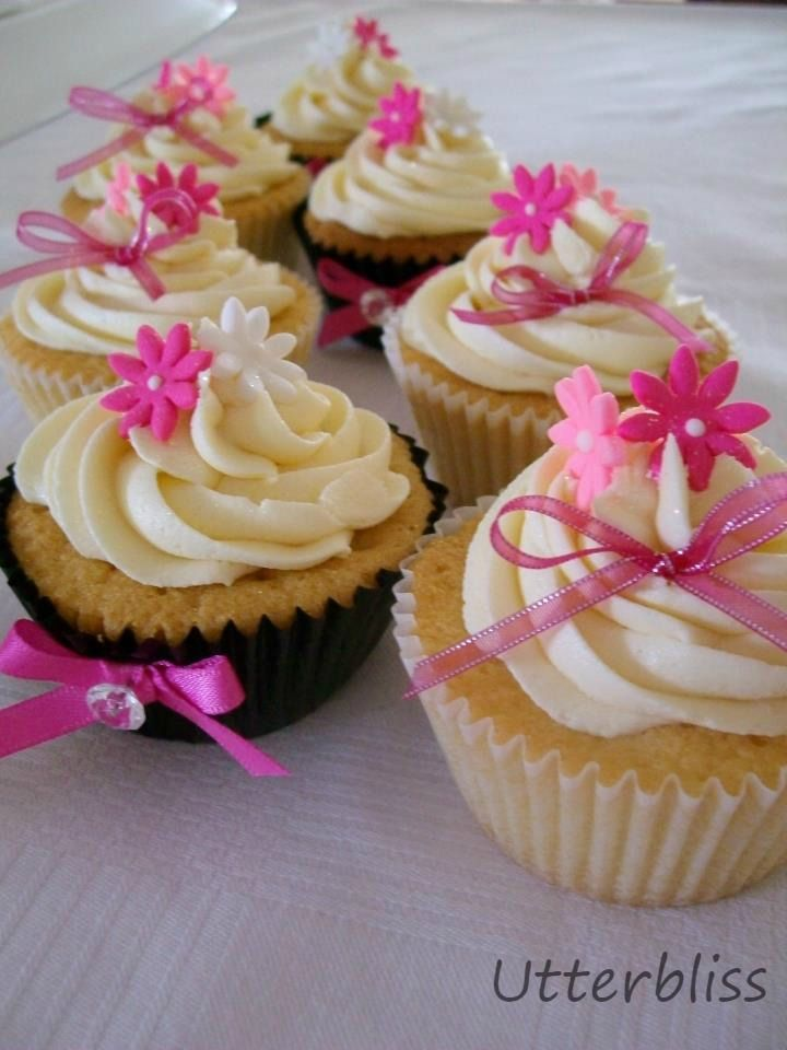 Pink bow vanilla cupcakes
