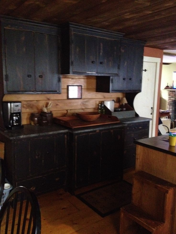 Love These Distressed Kitchen Cabinets In Black Primitive Kitchens Primitive Ki Primitive Kitchen Cabinets Country Kitchen Cabinets Black Kitchen Cabinets