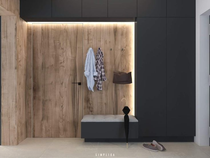 Scandinavian Modern entryway. Dark grey and natural wood tones. Modern touches in the lighting.
