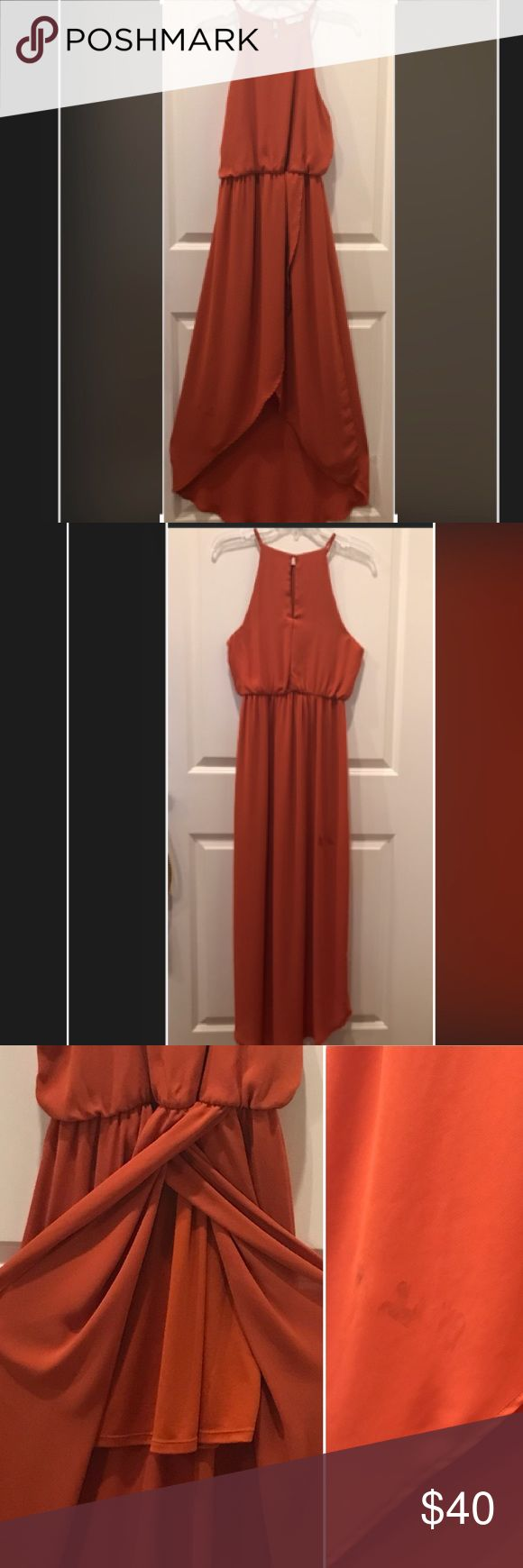 """High low dress When I wear this I feel like a supermodel! So elegant  & comfortable; w/slip underneath (see photos). 1 stain on front left of skirt & 2 stains on back skirt(see photos).  Not very noticeable bc dress flows.  Selling bc arms are too big for me.  Back:59""""long w/6"""" long keyhole opening w/top 1 button closure; 12"""" from top strap to bottom of arm opening; across arm to arm 18""""; top 13"""" Long; waist 13"""" across but stretches. Skirt @ shortest 23"""" long, slip:15"""" long from waist . 100%…"""