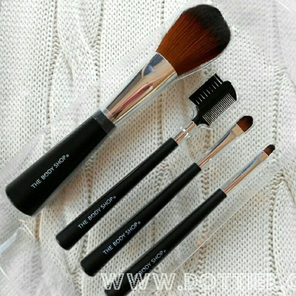 The Body Shop Brush Collection - NEVER USED 1. Face and Body Brush 2. Brow Brush and Comb 3. Eyeshadow Brush 4. Concealer/Lipstick Brush 5. Brush Roll for storage Never been used, super soft brushes! Comes in original boxed/plastic packaging (but it's dented on two sides) MAC Cosmetics Makeup Brushes & Tools