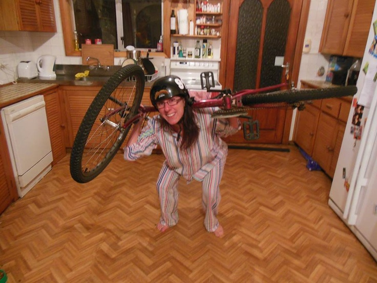 Nails squats with her trusty bike!