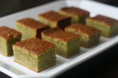 Matcha Mochi cake; Makes one 9X13 pan, or 24 squares: 1 lb box of mochiko flour (3 cups equivalent) 2 1/2 cups of sugar 2 teaspoons of baking powder 4 teaspoons of matcha powder 1/4 teaspoon salt 1 14 oz cans of coconut milk – not lowfat 1 12 oz can evaporated milk 5 large eggs 1 stick of butter (1/2 cup of butter) melted and slightly cooled