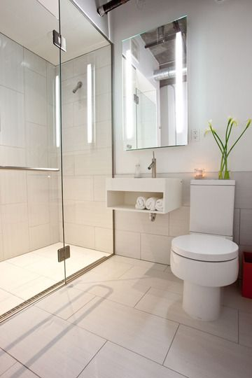 modern small bathroom - I love that there's no ledge separating the shower floor from the rest of the bathroom floor, and I think I see a linear drain along the shower glass. I love it so much. Floor big tiles.